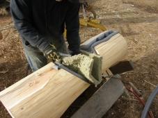 Batt Insulation cut to fit log notch